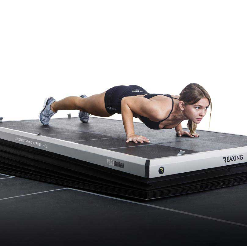 athelete do push-ups on Reax Board floor