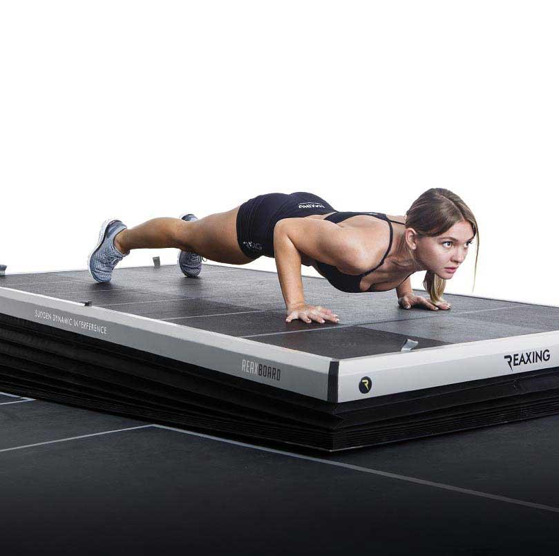 athelete do push-ups on Reax Board floor