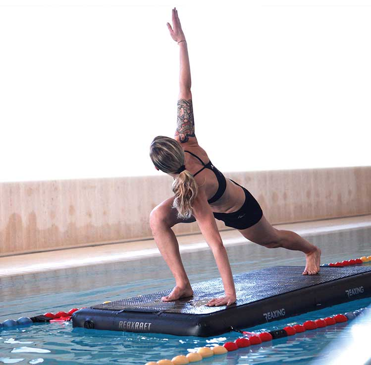 Athletes Yoga Activity on Reax Raft in the pool