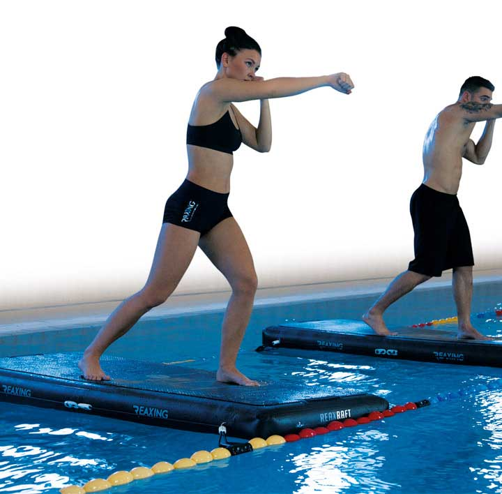 Athletes functional training on Reax Raft in the swimming pool