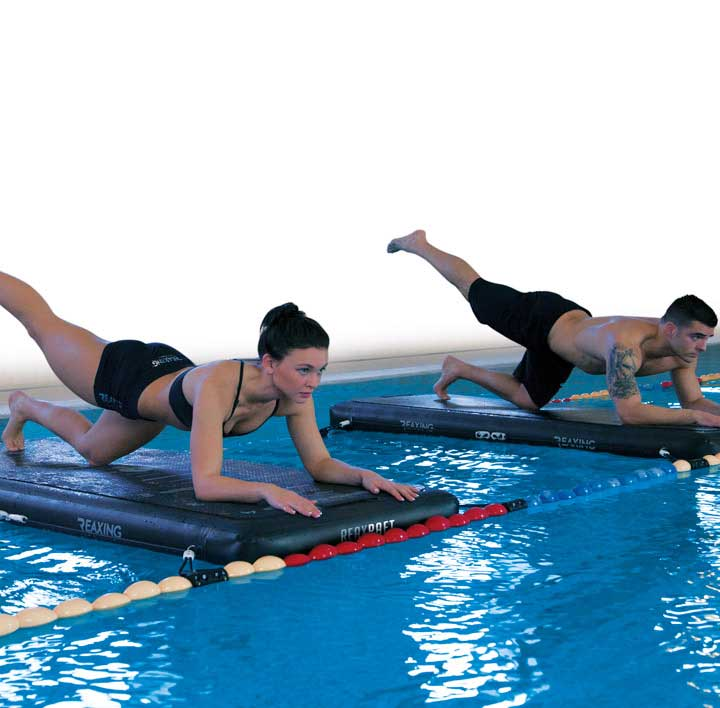 Athletes training workout on Reax Raft in the swimming pool