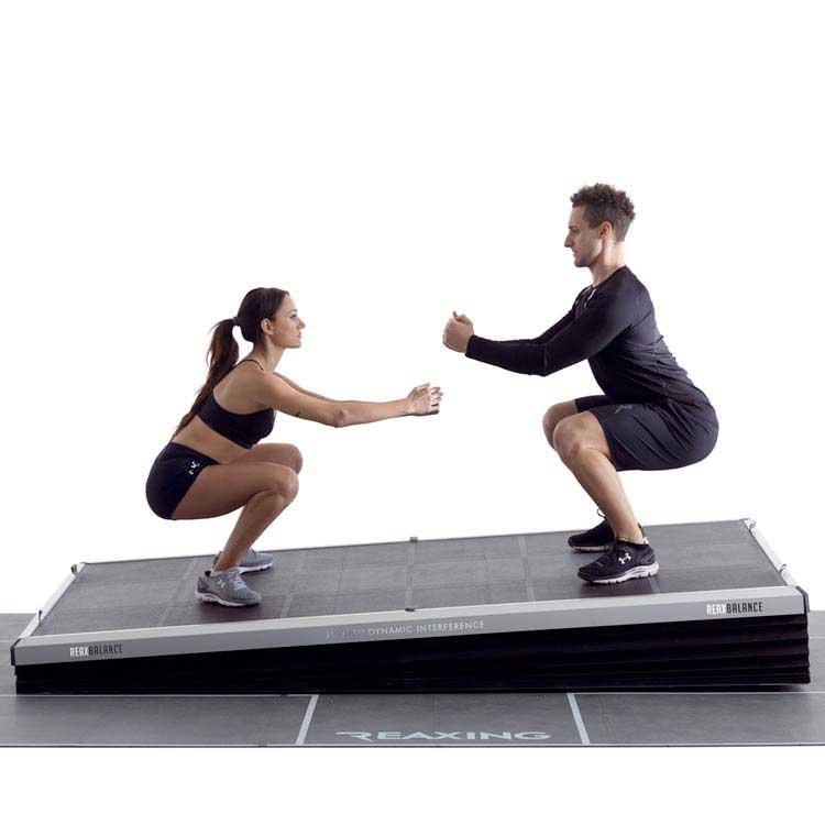 two athletes on reax balance floor train pre-configured training programs