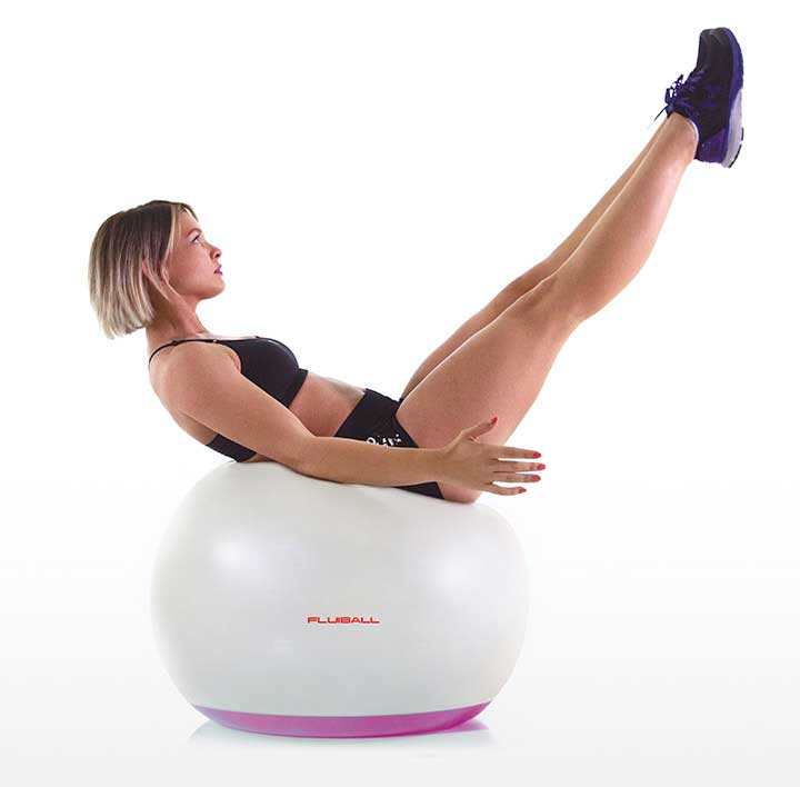 athlete on a big fluiball play functional training exercices