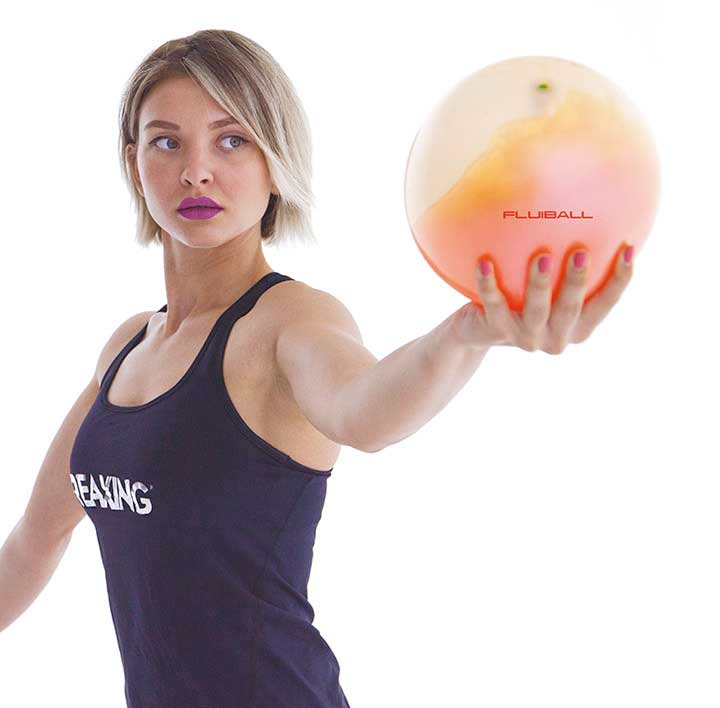 athlete with a fluibal in her hand