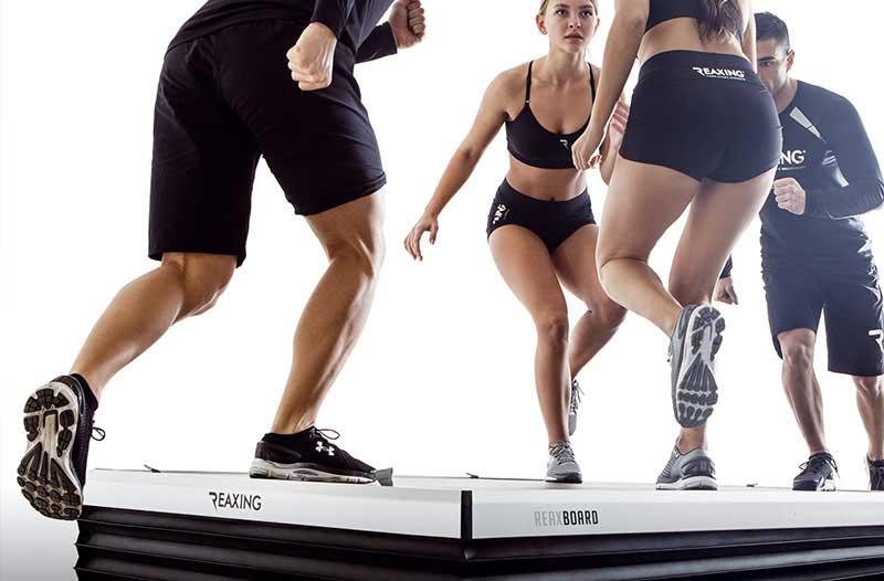 group of athletes on reax board floor train pre-configured training programs